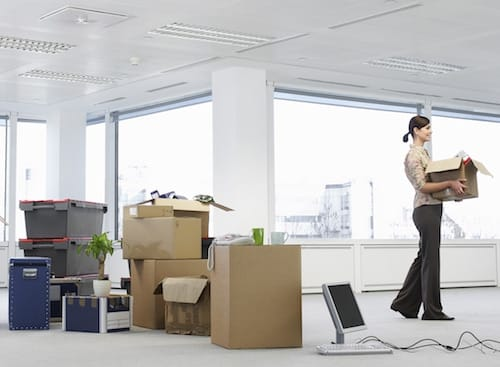 business-woman-carrying-boxes-in-office-space