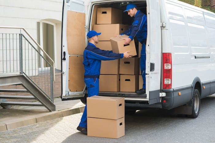 movers-carefully-pulling-boxes-out-of-a-white-van-3