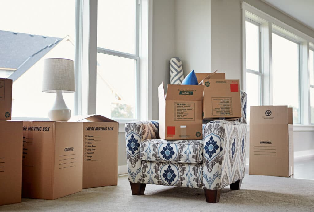Cardboard boxes piled on an armchair