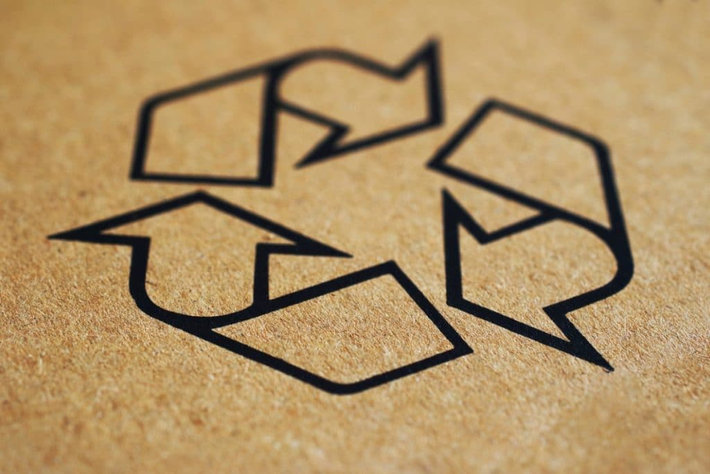 Recycle symbol on cardboard moving box