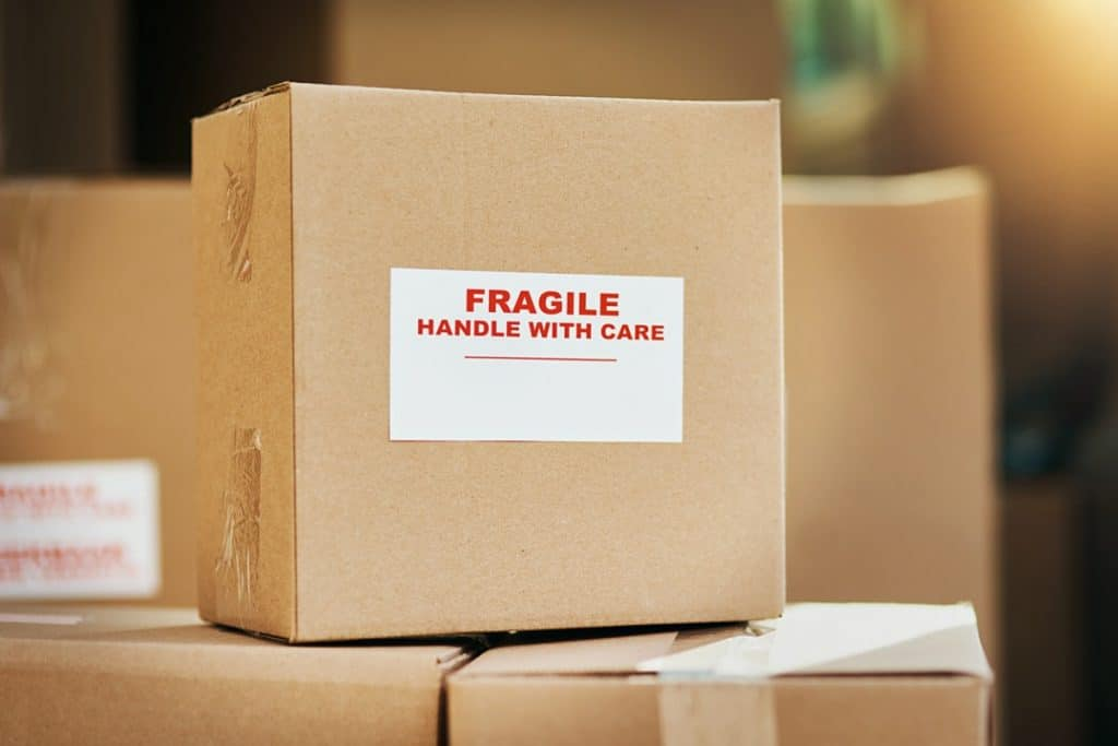 Moving boxes labeled with fragile stickers