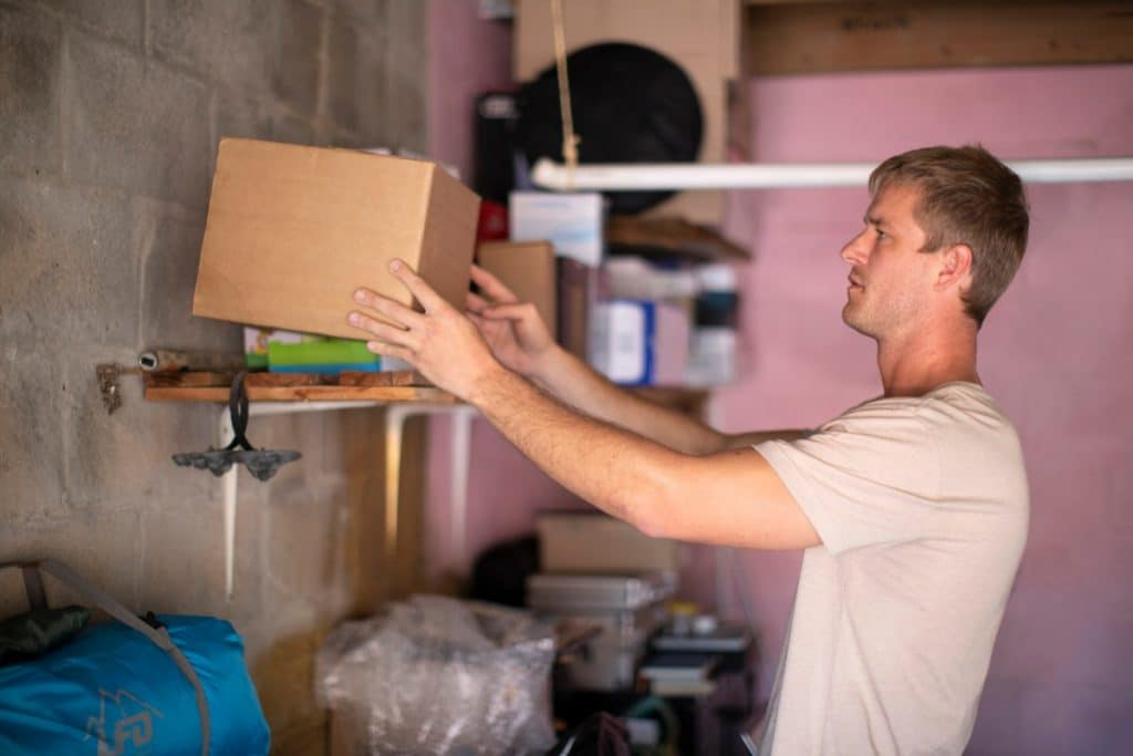Man in his garage selecting a box to use for packing