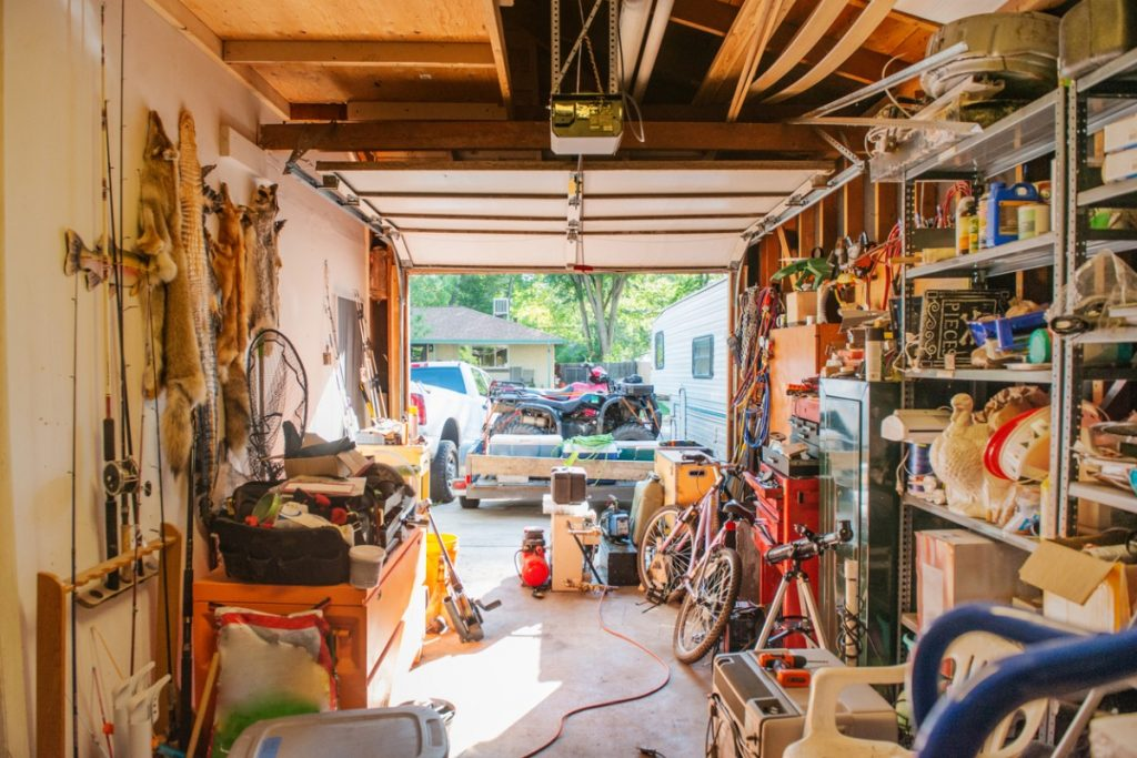 A cluttered garage, just one example of an area that may require additional storage when planning a move