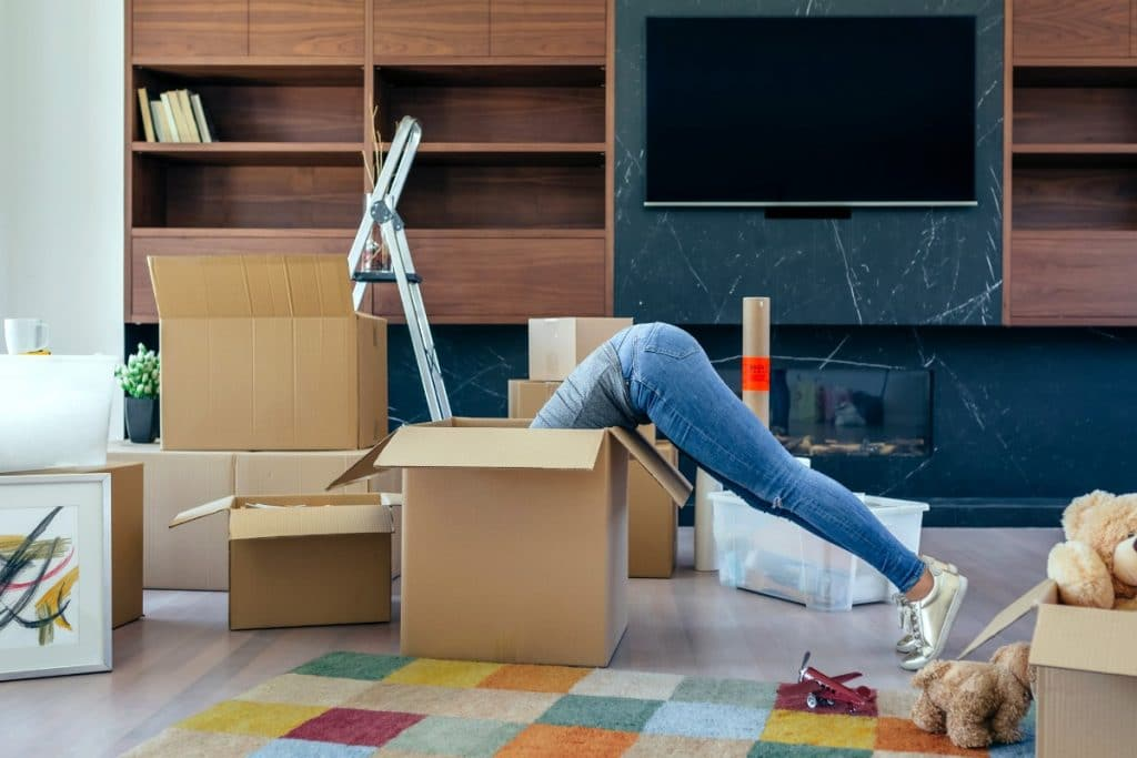 Woman searching the inside of a box while planning to move