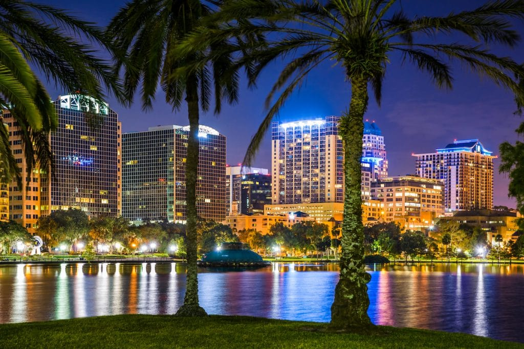 Photo of Lake Eola with cityscape in background.