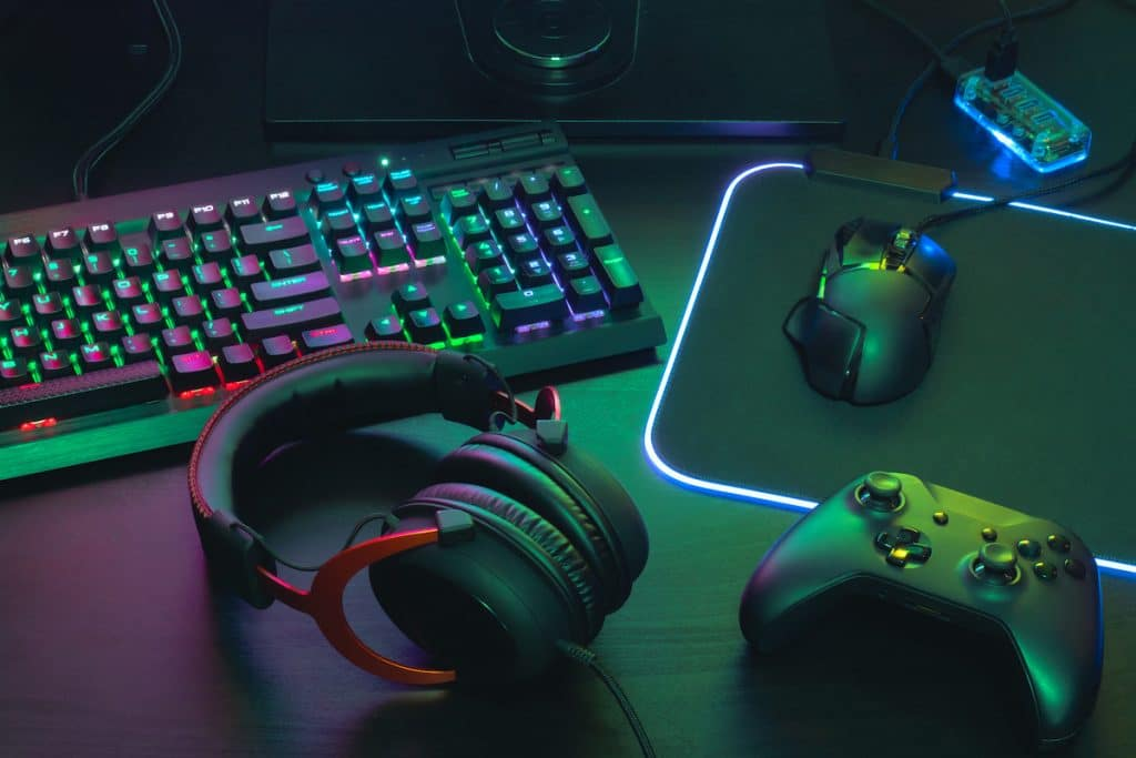 Various electronics like a keyboard, headphones, mouse, and game controller.