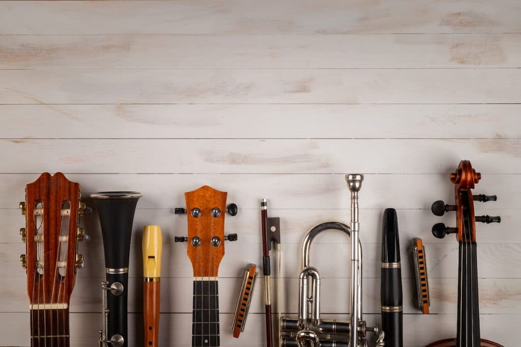 Tops of instruments against white wood background.