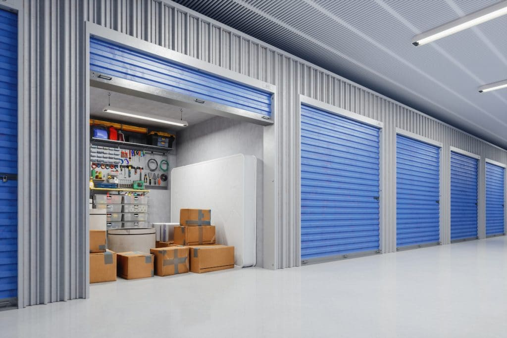 Storage facility with an open unit with boxes stored inside.