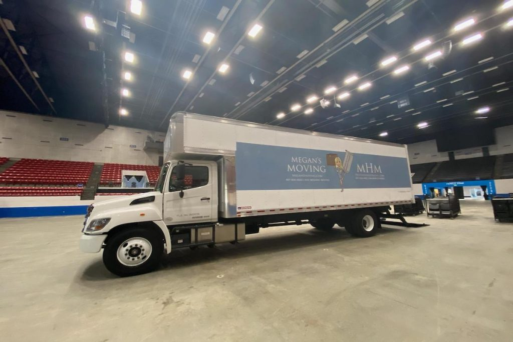 Megan's moving truck inside an arena.