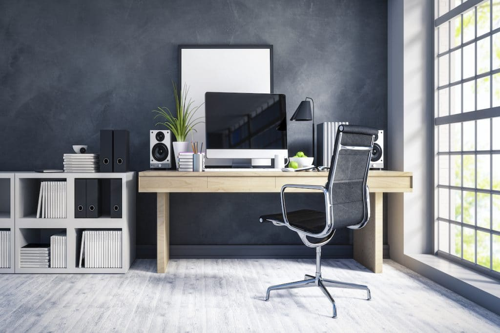A home office with a gray color scheme and wooden desk.