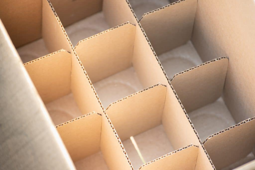 The interior of a box with dish barrels.