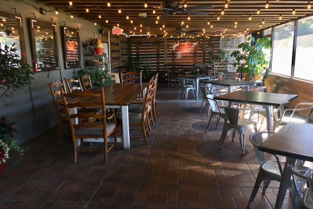 The interior of F&D Woodfire Pizza Kitchen and indoor seating.