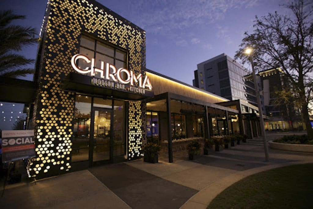 The exterior of Chroma restaurant at night time.