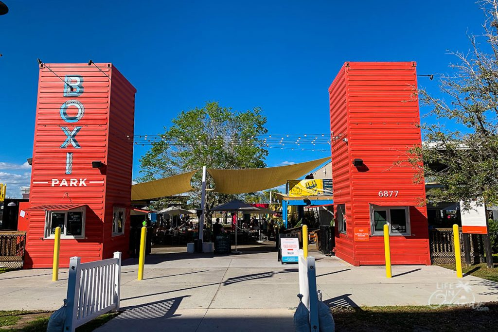 Boxi Park entrance with red vertical shipping containers.