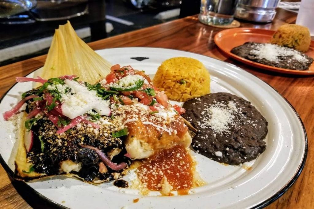 A Mexican plate with tamale, rice, and beans from Tamale Co.