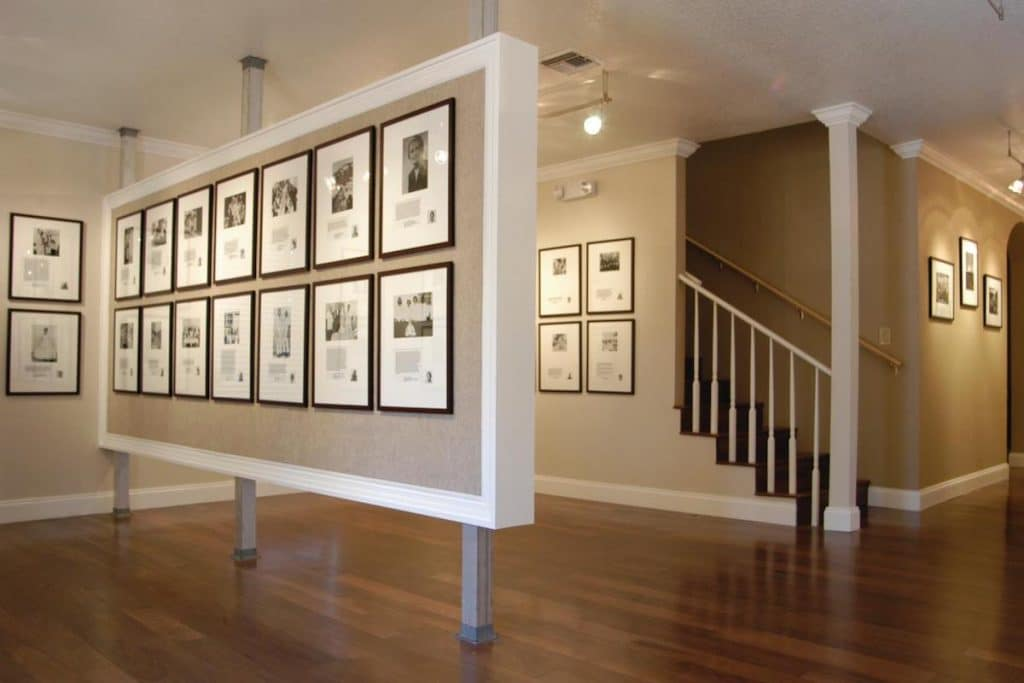 The inside of the Hannibal Square Heritage Center with framed photos on the wall.